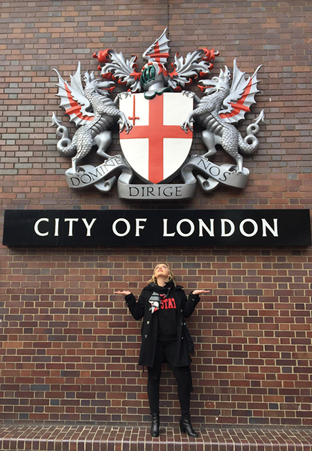 City of London sign with student photo