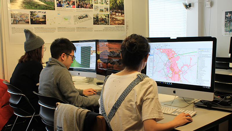 Students work on GIS programs to develop critical solutions