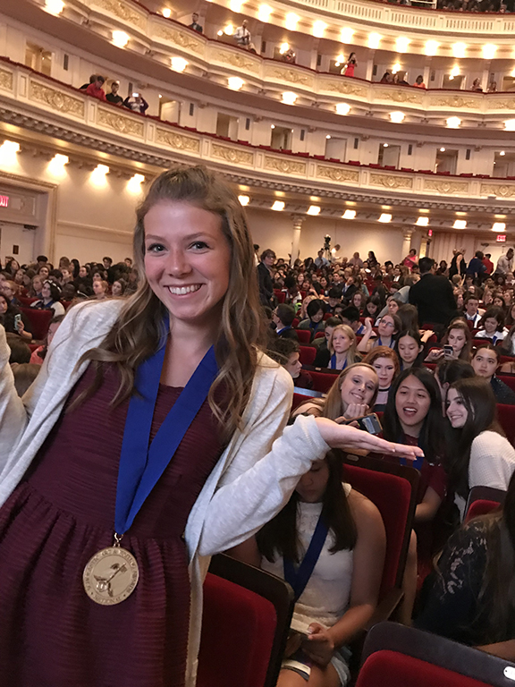 Victoria Kern at Carnegie Hall with her medal