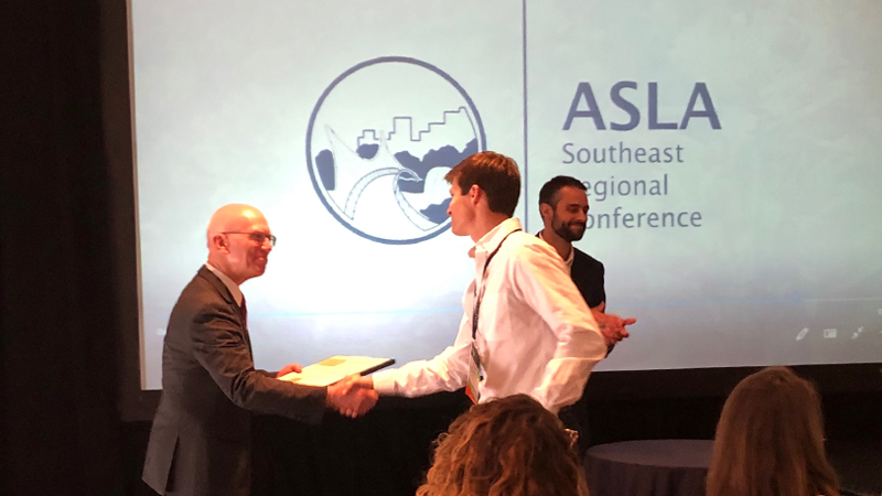 Travis Klondike accepting an award at the 2019 ASLA SER Conference