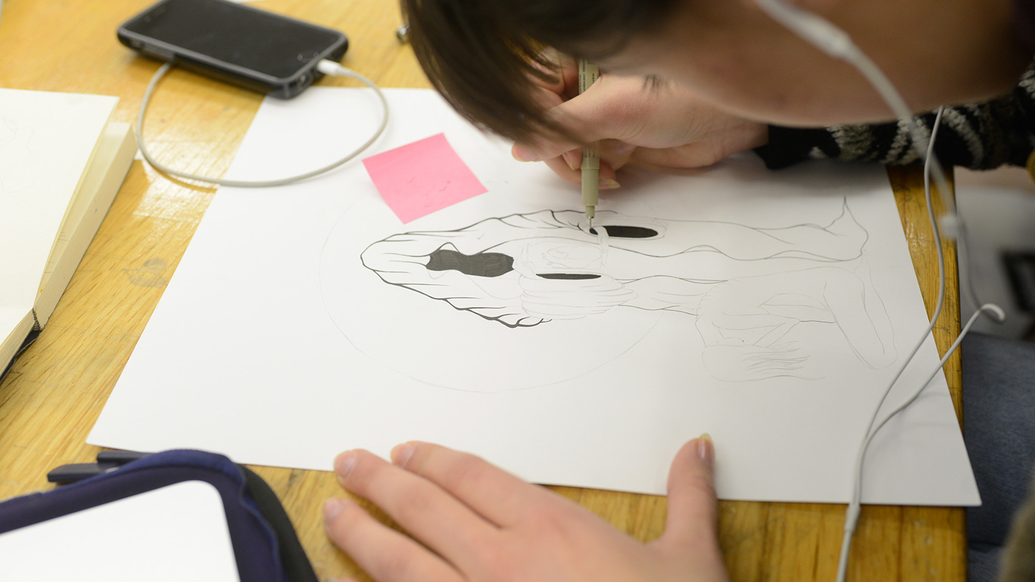 Student working on a drawing