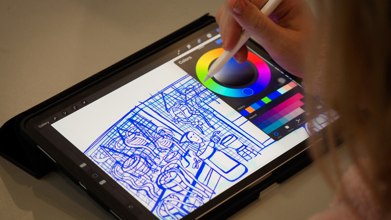Student drawing on tablet