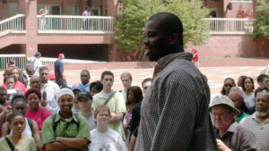 Najja Baptist speaking to a protest crowd on NC State's brickyard in 2002; Photo taken by Demarcus Williams.